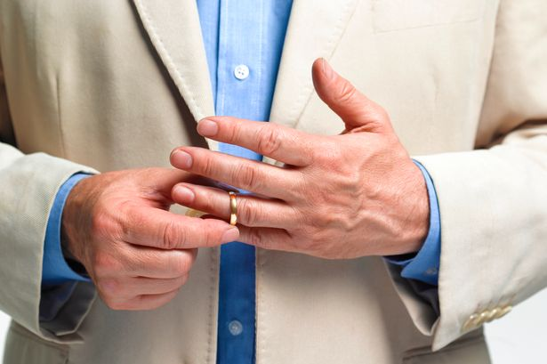 A married man takes off his vow ring