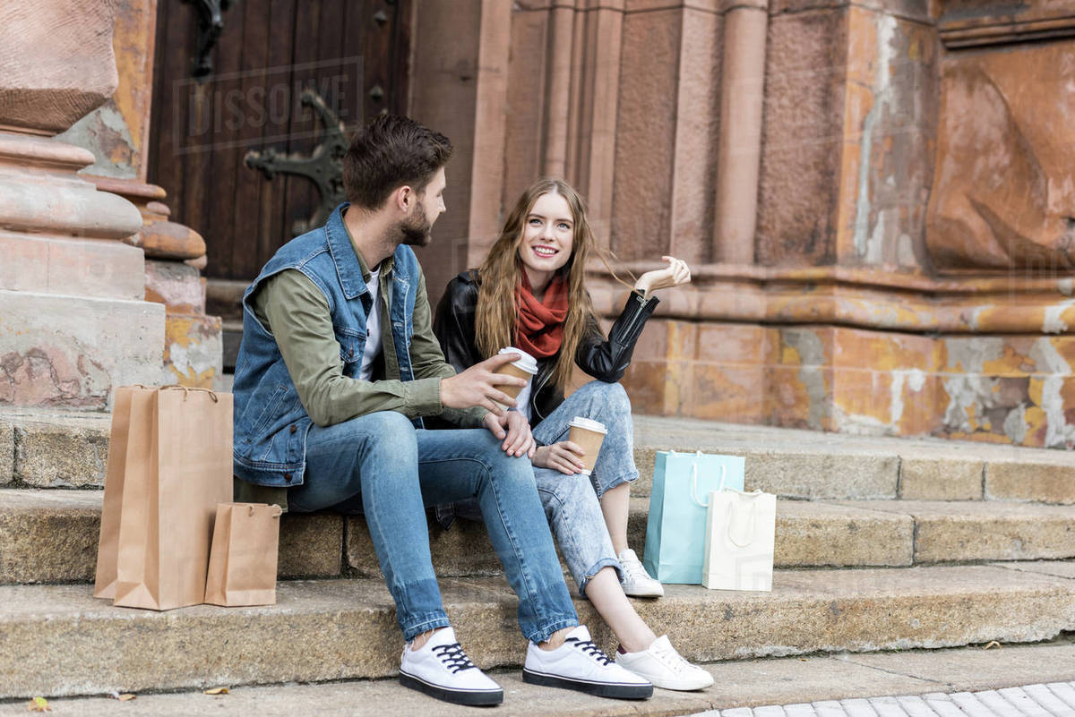 couple-with-coffee-on-the-street
